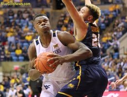 West Virginia forward Oscar Tshiebwe bulls his way past Northern Colorado's Kai Edwards