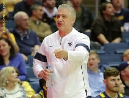 West Virginia assistant coach Ron Everhart points out a flaw in a foul call