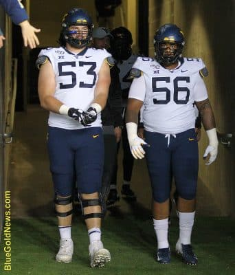 West Virginia's two best players, Colton McKivitz and Darius Stills, prepare to lead the team out as game captains