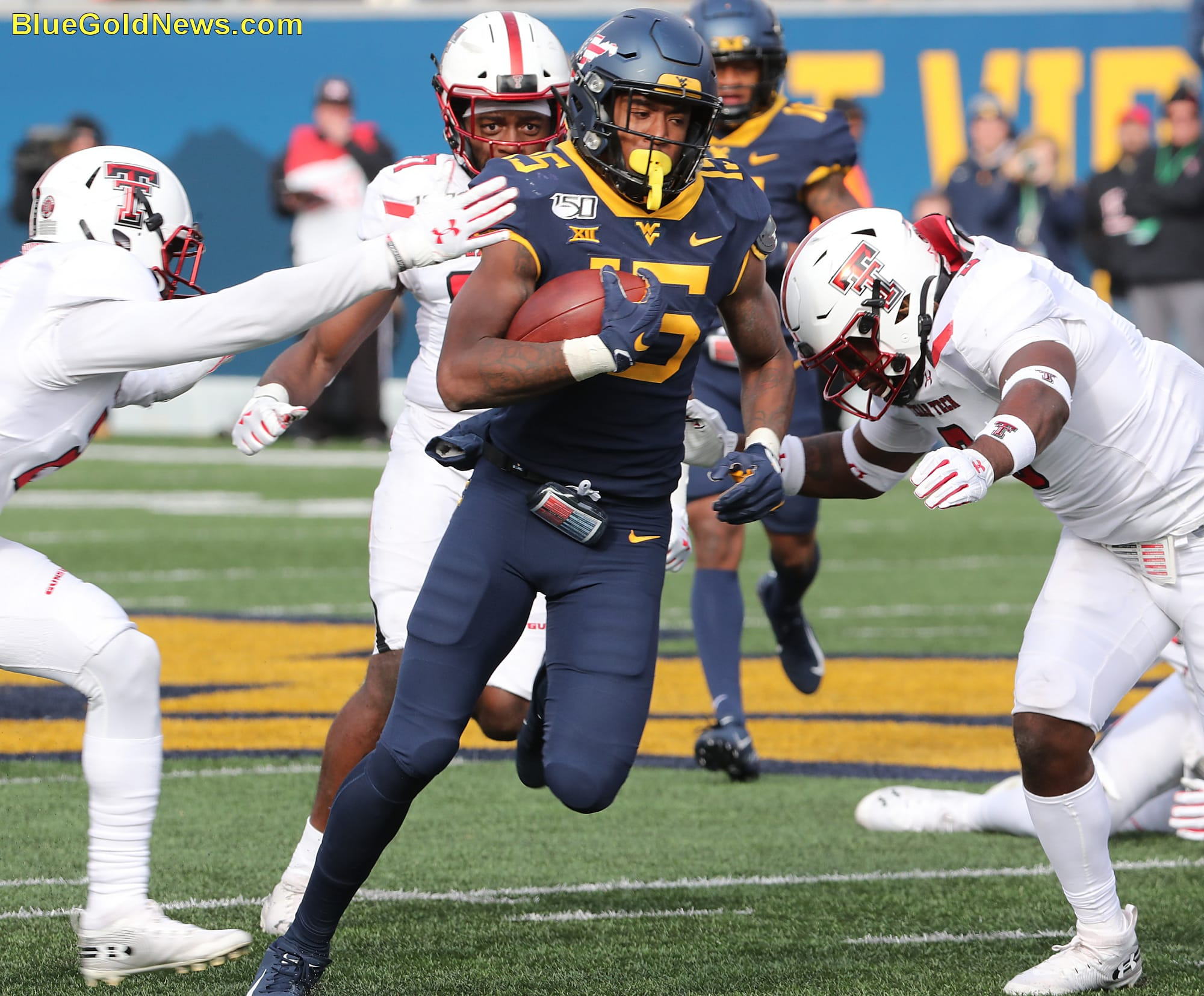 West Virginia receiver George Campbell tries to split a pair of Texas Tech defenders