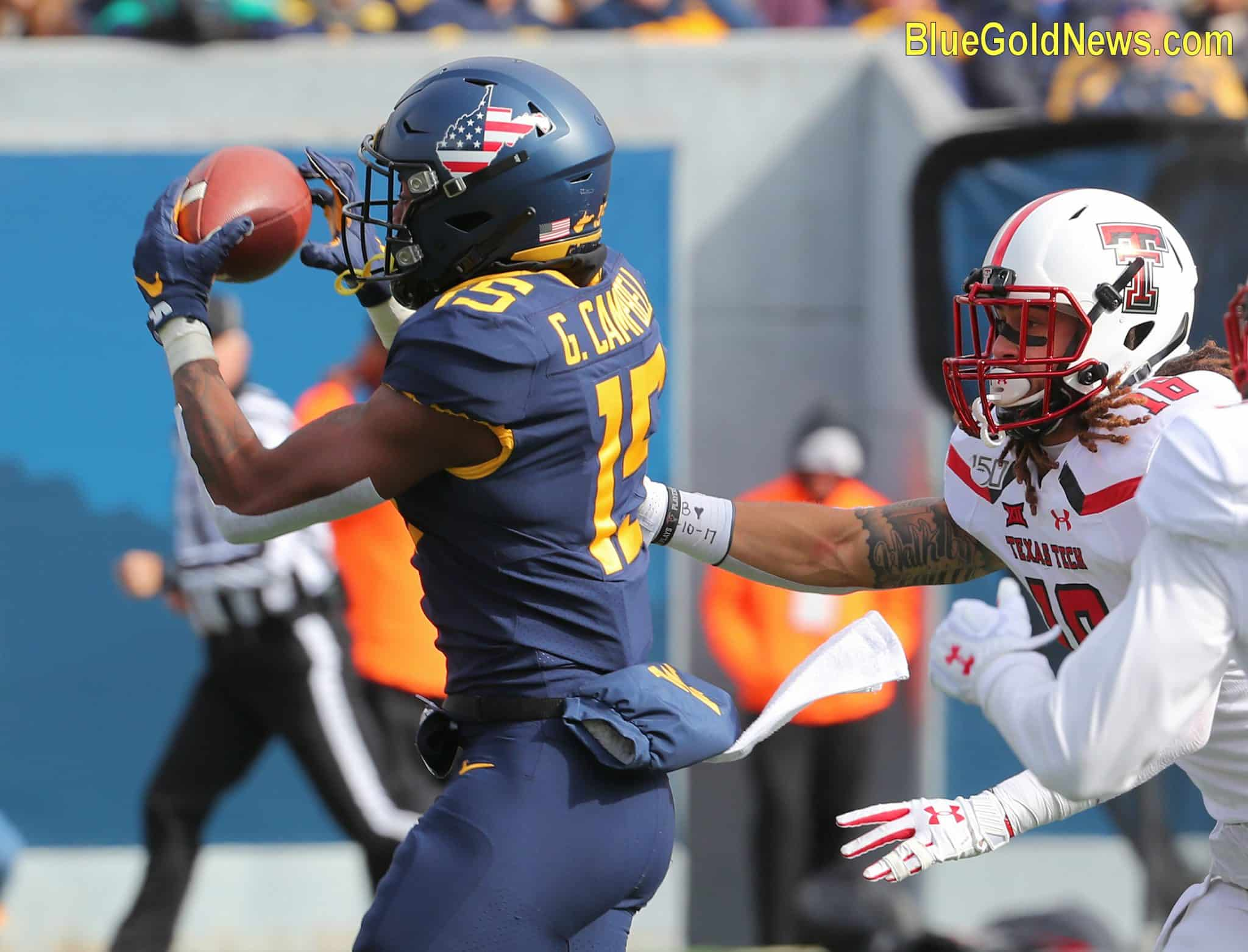 West Virginia receiver George Campbell (15) hauls in a long reception behind Texas Tech's Thomas Leggett (16)
