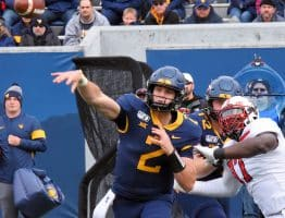 West Virginia quarterback Jarret Doege sends a pass on its way