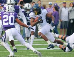 West Virginia running back Kennedy McKoy cuts back against the Kansas State defense