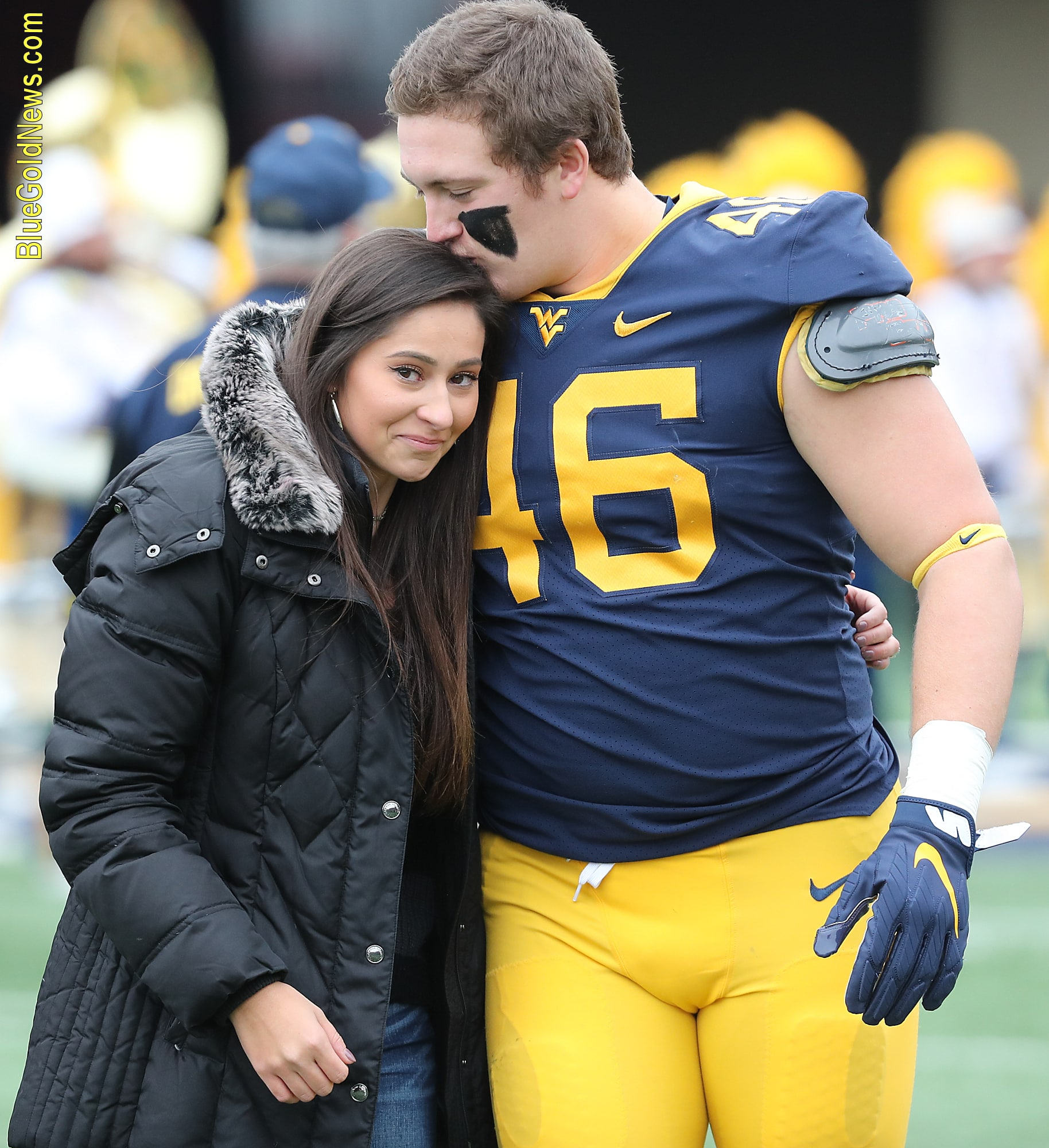 West Virginia senior Reese Donahue greets fiancee Sarah Moore