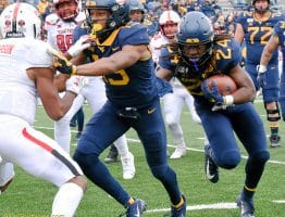 West Virginia running back Tony Mathis (24) follows the block of Ali Jennings
