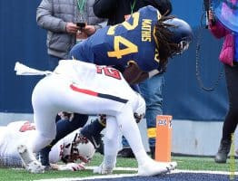West Virginia running back Tony Mathis (24) scores his first collegiate touchdown