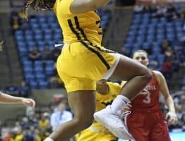 West Virginia guard Kirsten Deans goes up for a lay-up