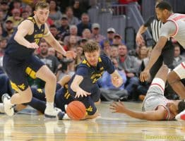 West Virginia guard Chase Harler dives for a loose ball in the win over Ohio State