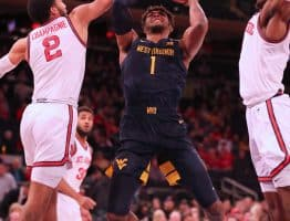 West Virginia forward Derek Culver (1) works in the lane against the St. John's defense