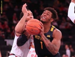 West Virginia forward Derek Culver (1) grimaces with effort