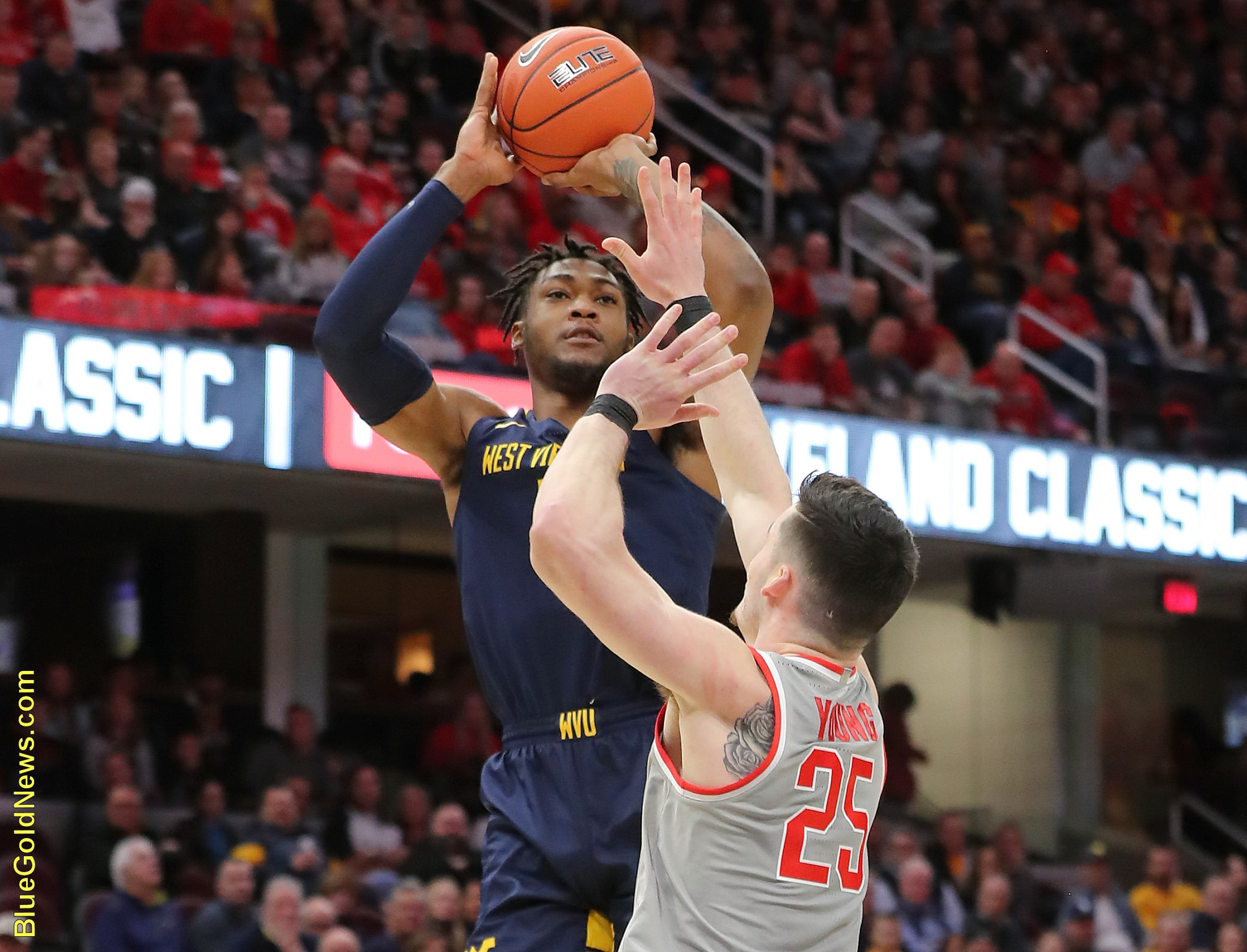 West Virginia forward Derek Culver drains a jumper over Ohio State's Kyle Young (25)
