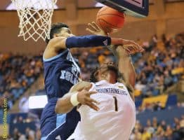 West Virginia forward Derek Culver (1) didn't get a foul call on this hack by Rhode Island's Jacob Toppin (21)