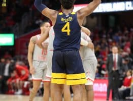 West Virginia guard Deuce McBride signals to the crowd in the final seconds of the Mountaineers' win over Ohio State