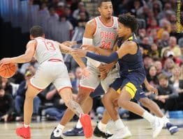 West Virginia guard Deuce McBride is picked by a leaning Kaleb Wesson (34) of Ohio State