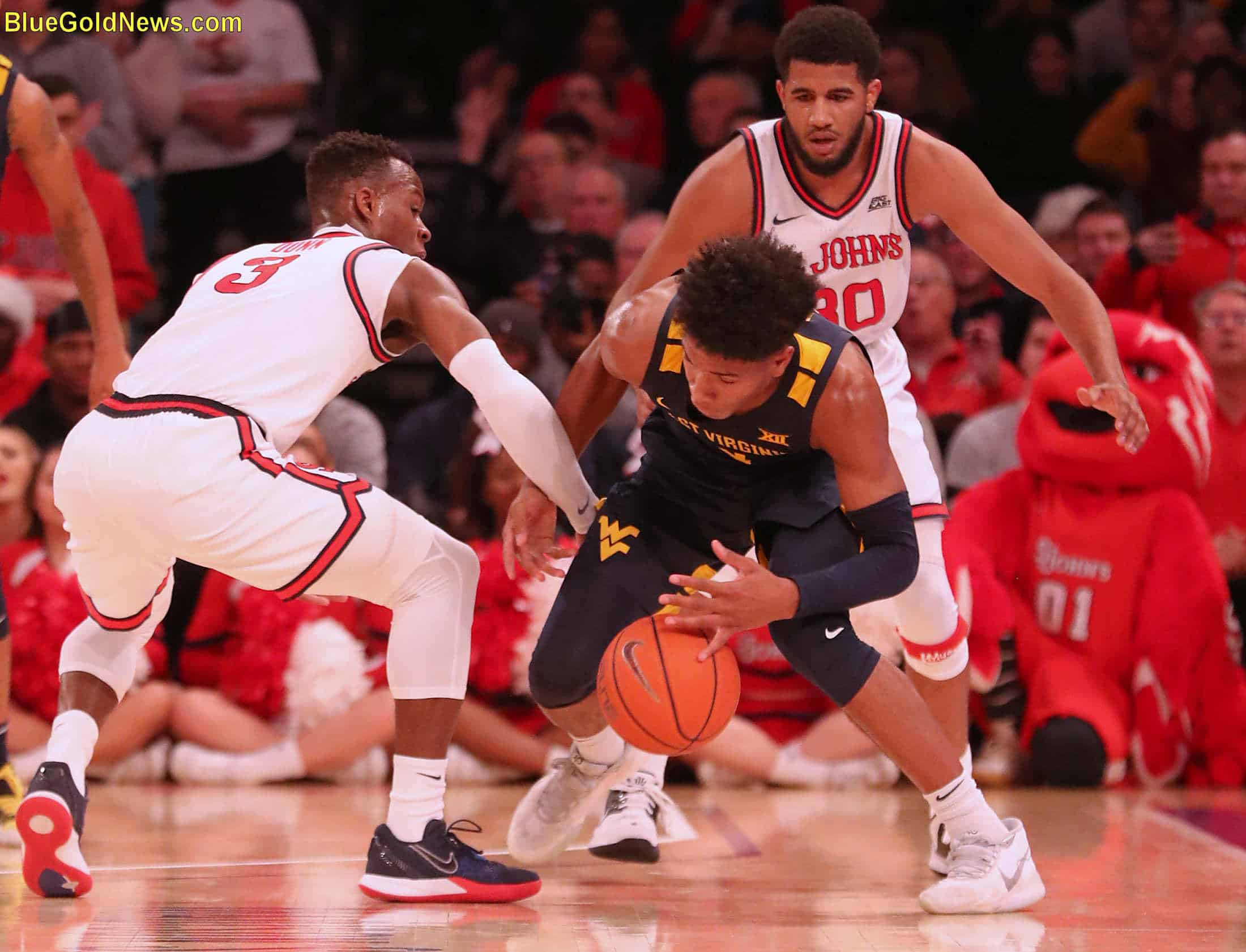 West Virginia guard Deuce McBride comes up with one of WVU's few loose ball wins
