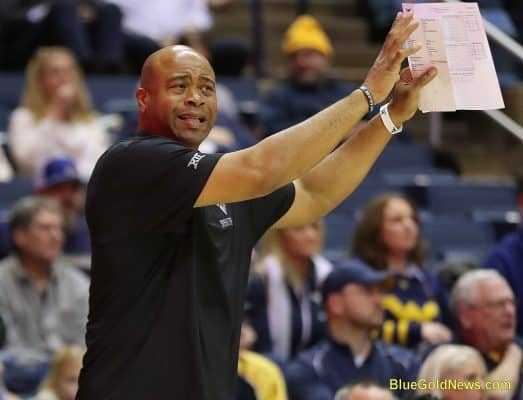 West Virginia assistant coach Erik Martin demonstrates a technique for one of his post players
