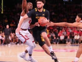 West Virginia forward Jermaine Haley (10) protects the ball on a drive against St. John's Greg Williams (4)