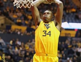 West Virginia forward Oscar Tshiebwe eyes the rim on a dunk
