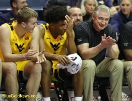 West Virginia assistant coach Ron Everhart (right) laughs in the closing moments of the win over Austin Peay