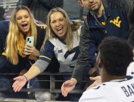 Deidre Kelley, mother of former WVU QB Skyler Howard (3) greets the Mountaineers after the win