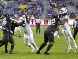 West Virginia defensive lineman Jeffery Pooler (13) bats down a TCU pass