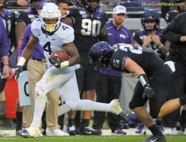 West Virginia running back Leddie Brown (4) runs by TCU's Wyatt Harris (25)