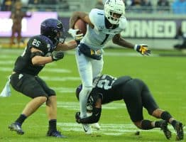 West Virginia receiver T.J. Simmons (1) is tripped up after a catch by TCU's Ar'Darius Washington (27)