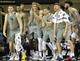 The West Virginia bench celebrates a Mountaineer 3-pointer