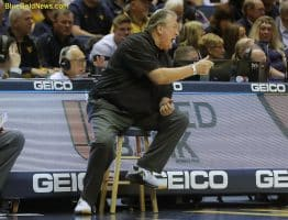 West Virginia head coach Bob Huggins yells instructions to his team