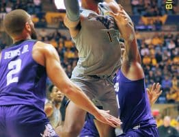 West Virginia forward Derek Culver scores over TCU's Desmond Bane