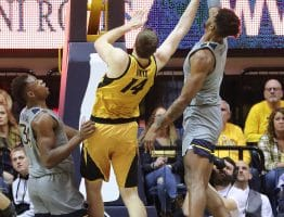 West Virginia forward Derek Culver (1) blocks the shot of Missouri's Reed Nikko (14)