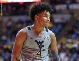 West Virginia guard Deuce McBride soaks in cheers from the crowd after WVU forces a shot clock violation