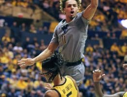 West Virginia forward Emmitt Matthews (11) is undercut by Missouri's Mitchell Smith (5)