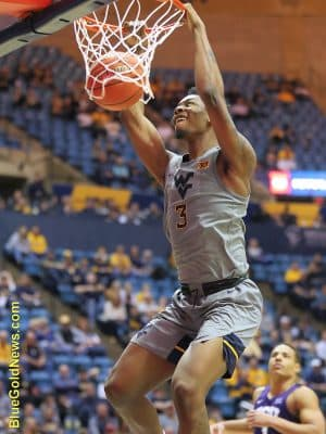 West Virginia forward Gabe Osabuohien jams home two as the Mountaineers pull away from TCU