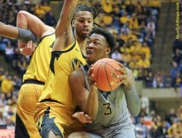 West Virginia forward Gabe Osabuohien (3) is pushed on a drive against Missouri