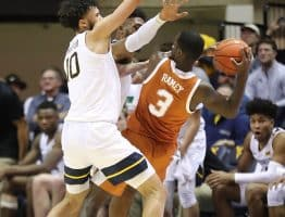 West Virginia forwards Jermaine Haley (10) and Derek Culver (back) force Texas' Courtney Ramey (3) into a travel