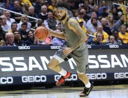 West Virginia forward Jermaine Haley pushes the ball upcourt in transition