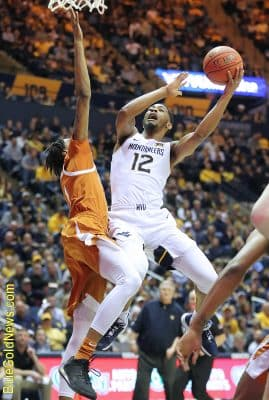 West Virginia guard Taz Sherman (12) emotes as he rises in the lane to get a shot away against Texas