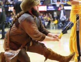 West Virginia Mountaineer Timmy Eads loads a gift for a fan into a slingshot
