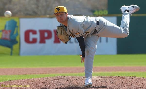 West Virginia pitcher Jake Carr delivers to the plate