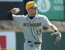 West Virginia infielder Kevin Brophy makes a throw to first