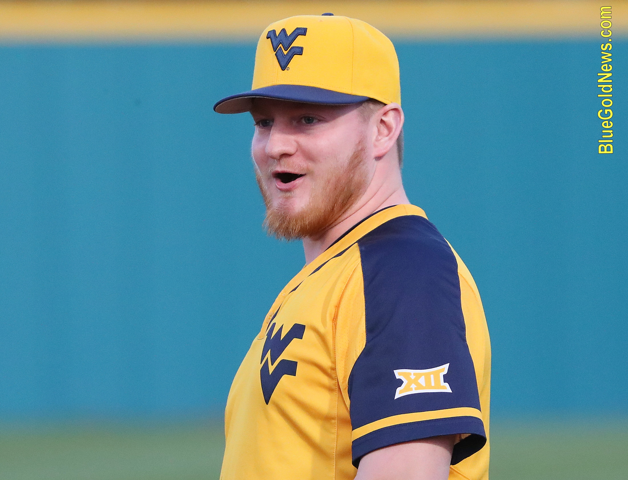 West Virginia infielder Matt McCormick reacts to cheers from the dugout after a diving stop