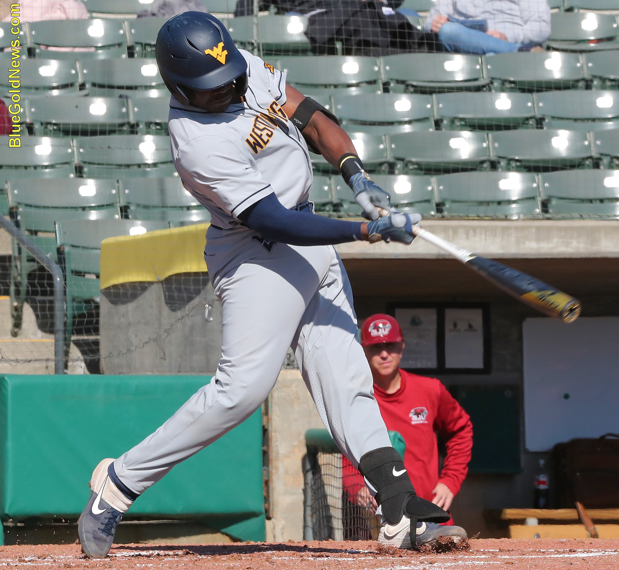 West Virginia catcher Paul McIntsoh crushes a solo home run to left against St. Joseph's