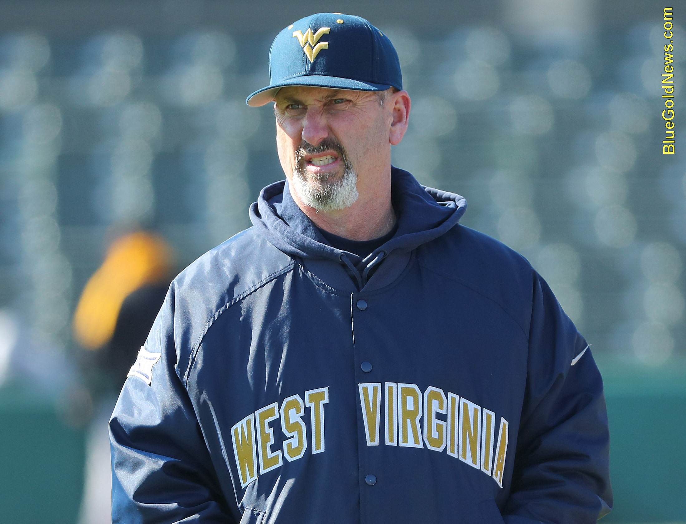 West Virginia coach Randy Mazey shows some grit in the blustery wind
