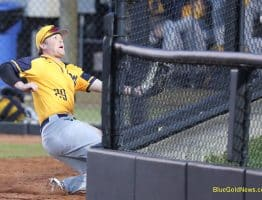 West Virginia outfielder Tyler DeMartino makes a valiant effort for a fly ball