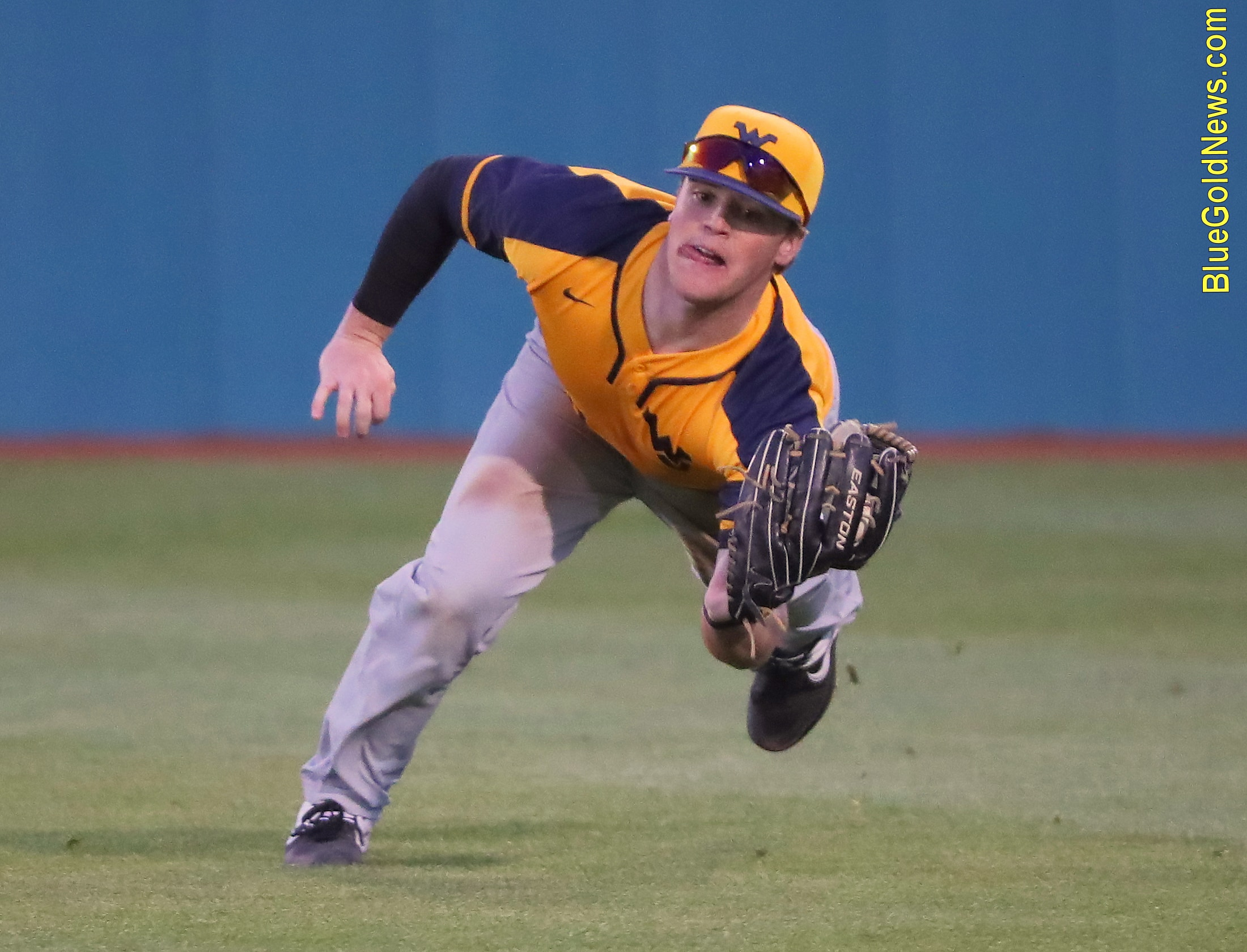 West Virginia outfielder Tyler DeMartino makes a diving catch