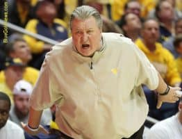 West Virginia head coach Bob Huggins shouts instructions to his team