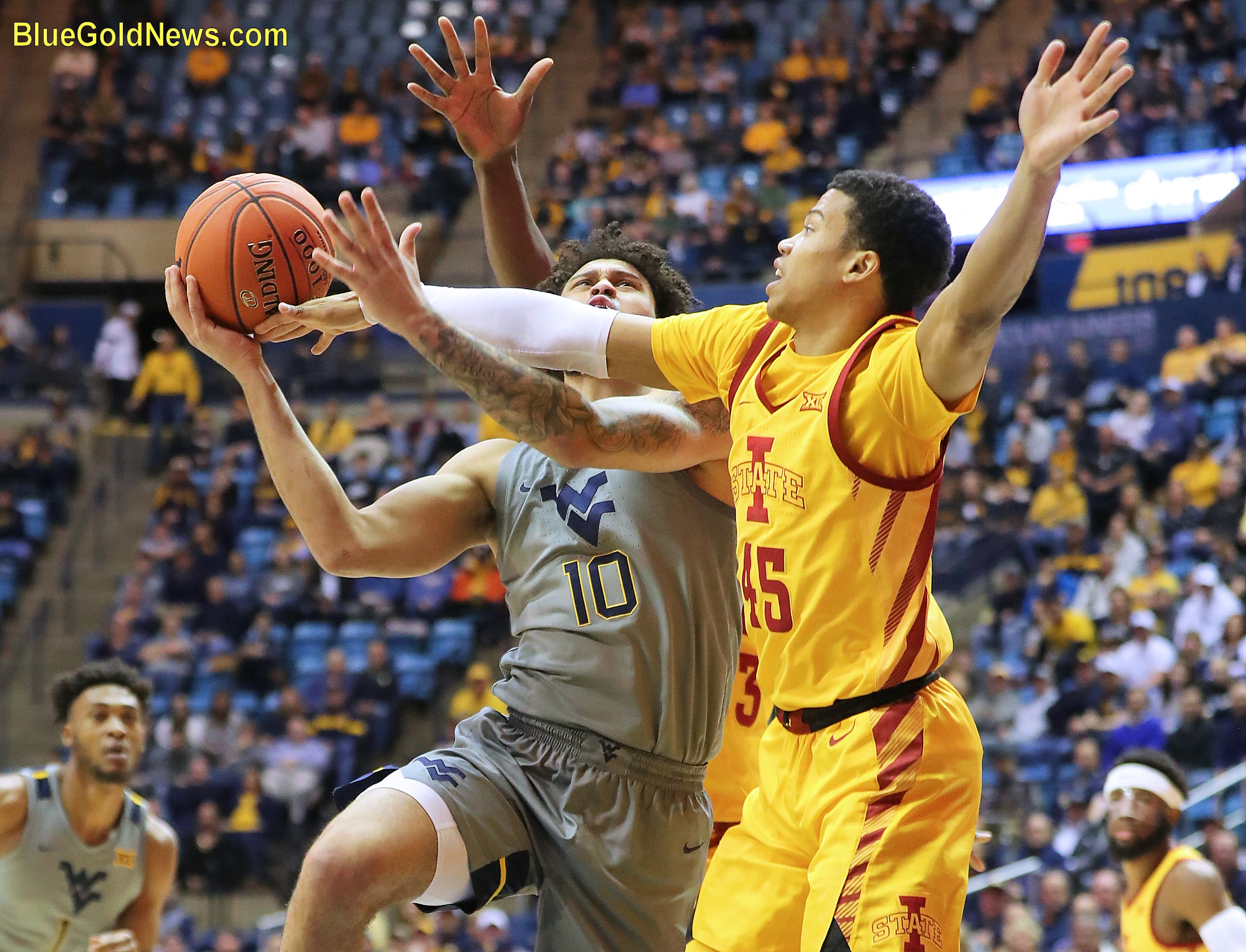West Virginia guard Jermaine Haley (10) is fouled by Iowa State's Rasir Bolton (45)