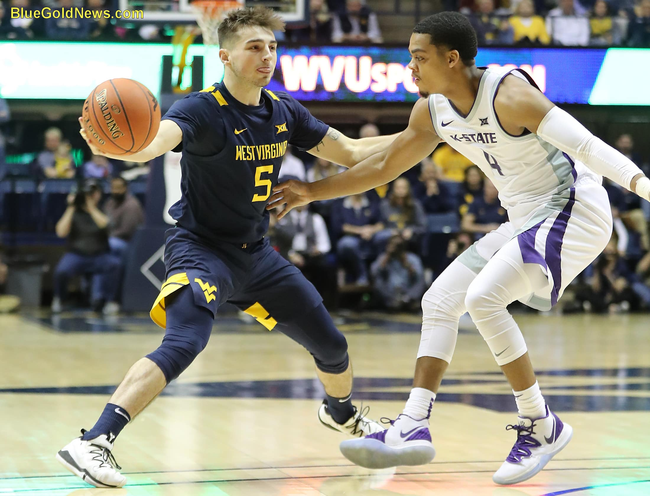 jordan mccabe (5) wraps an entrance pass around david sloan's kansas state's (4)