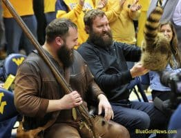 West Virginia Mountaineer Timmy Eads laughs as Ben Roethlisberger checks out his coonskin cap